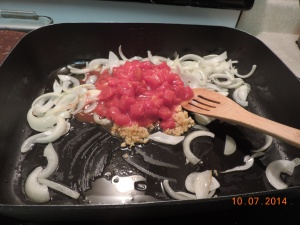 2 Onions, sliced 2 T. garlic, minced 1 can diced tomatoes 1 can jalapenos 1 T. oil Saute until veggies are tender